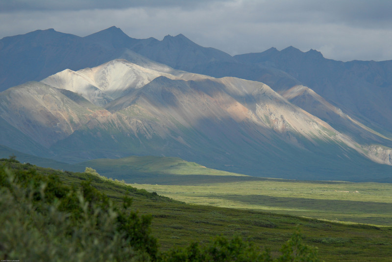 Sunlit mountains and tundra.