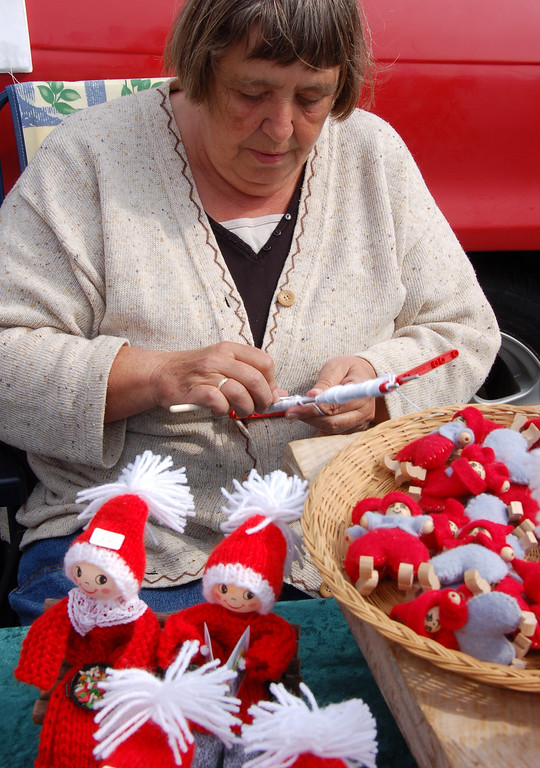 Doll maker<br /> <br /> This lady created dolls and sold them at the local market.