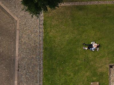 Couple sleeping on grass in churchyard Denmark