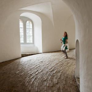 Girl running inside round tower Copenhagen Denmark, 2009.