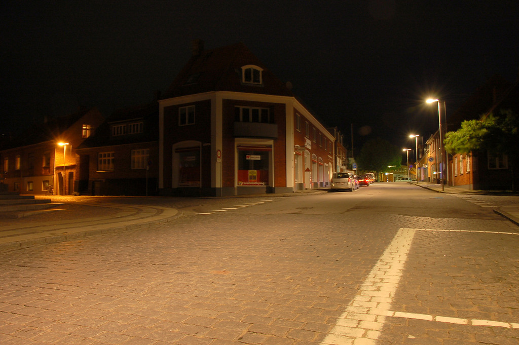 Deserted road <br /> <br /> Ronne (in Bornholm) is a small town and with not very many people (the total pop. of the island is ~45,000) we freely walked through the deserted streets. After midnight, even the street lights go out.