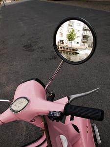 Pink motorscooter mirror Copenhagen Denmark