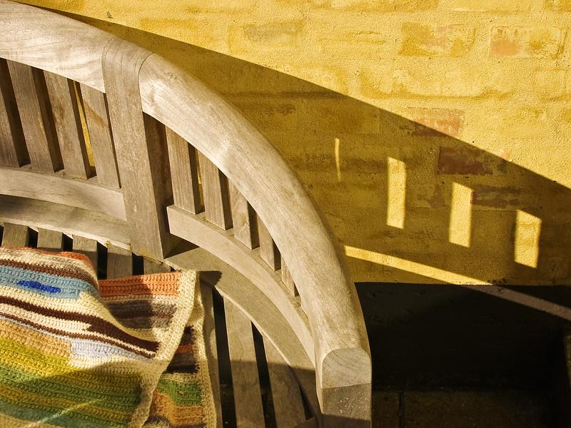 Denmark teak bench blanket shadow yellow wall