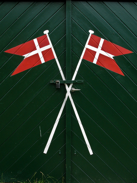 Danish flags green shed door Tisvilde Denmark