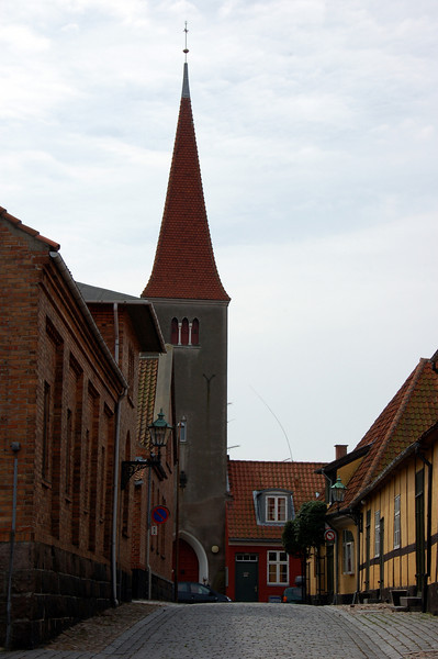 Church in Bornholm <br /> <br /> (the tall wire like thingy next to the tower is an antenna - need to clone it out at some point <br /> :( )