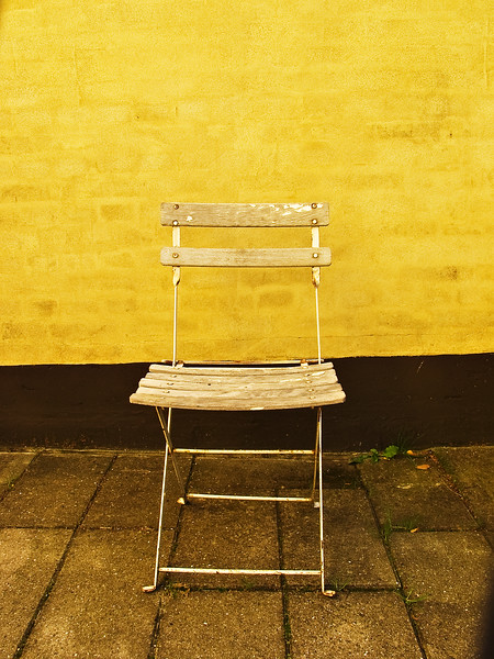 Denmark chair and yellow wall