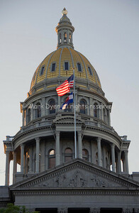 Denver Capitol and flagsat dawn
