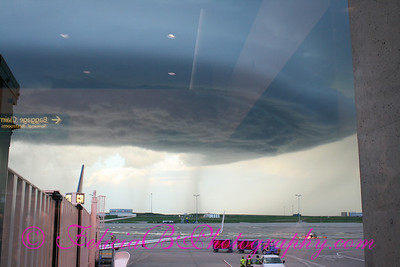 Funnel cloud over Denver airport.  The reason all flights were backed up the entire day!