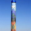 Paragon Prairie Tower, Urbandale (western Des Moines), Iowa  March 19, 2009.  The tower rises 120 feet,  measures 16 feet in diameter, the blue top itself is 8 ft. tall. The tower features one of the largest glass tiled murals in the U.S.  The scene on the tower is approx. 5,000 square feet.  There is an internal illuminated drum or globe at the top and is spectacular day and night.