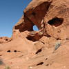 Many natural arches and holes in the colorful stone at Valley of Fire State Park
