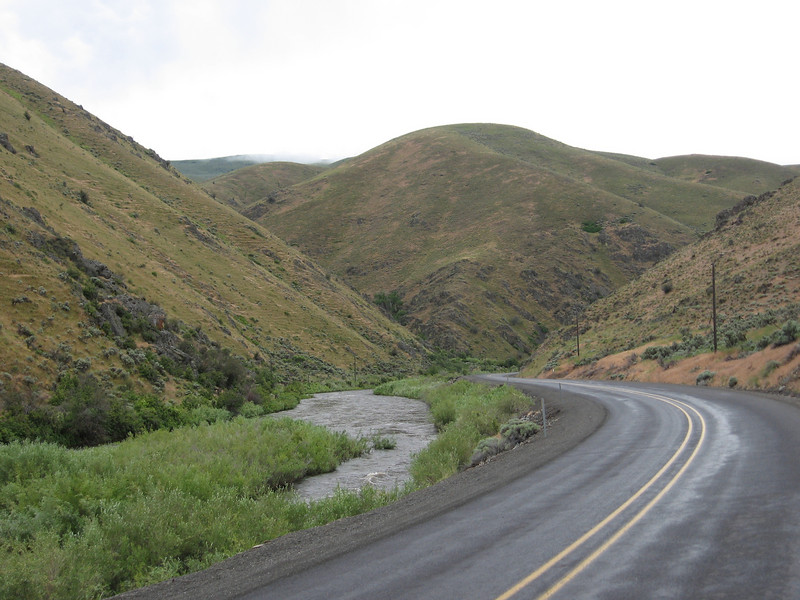 The road had very little traffic, and the weather got better in the afternoon. This is a long, very gently uphill section following the Powder River.
