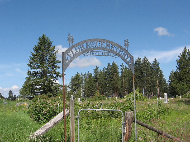 The Flora Cemetery is about a mile north of town.