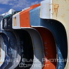 Fenders, stacked vertically against azure blue sky. [UFP082312]
