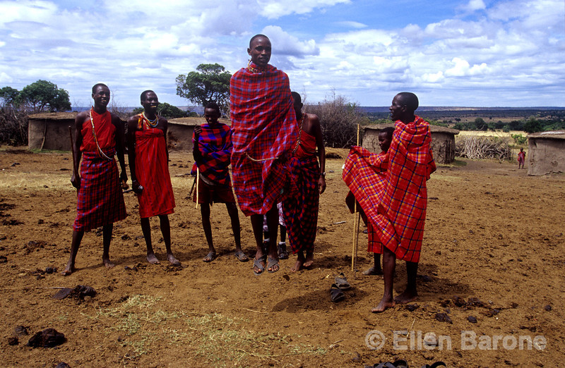 Masaai males perform traditional warrior dance, Masaai Mara National Reserve, Kenya, East Africa
