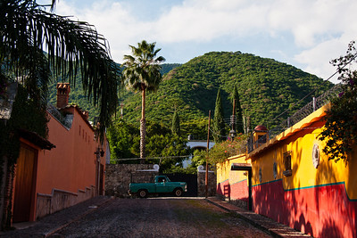 Cobblestone street, colorful pickup truck, mountain view, Ajijic, Jalisco, Mexico. Lago de Chapala (Lake Chapala)