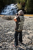 Cruise passenger, photographing waterfall, Big Port Walter, Baranof Island, southeast Alaska, USA.