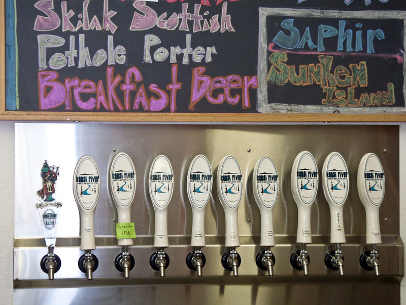 """Soldotna pioneers swing by the Kenai River Brewing Company where Breakfast Beer is on tap and local tradition dictates: """"get some for dinner tonight and breakfast tomorrow.""""  Soldotna, Alaska."""