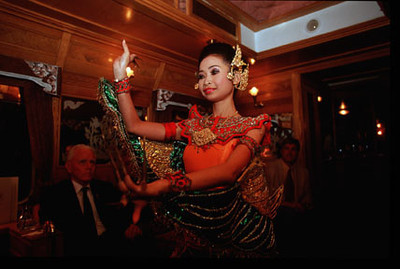 Thai dancer entertains aboard the Eastern and Orient Express luxury train that travels the Malay Peninsula between Singapore and Bangkok, Southeast Asia.