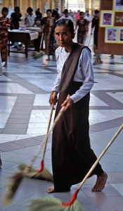 Woman sweeping the Shwedagon Pagoda, Myanmar/Burma, Southeast Asia.
