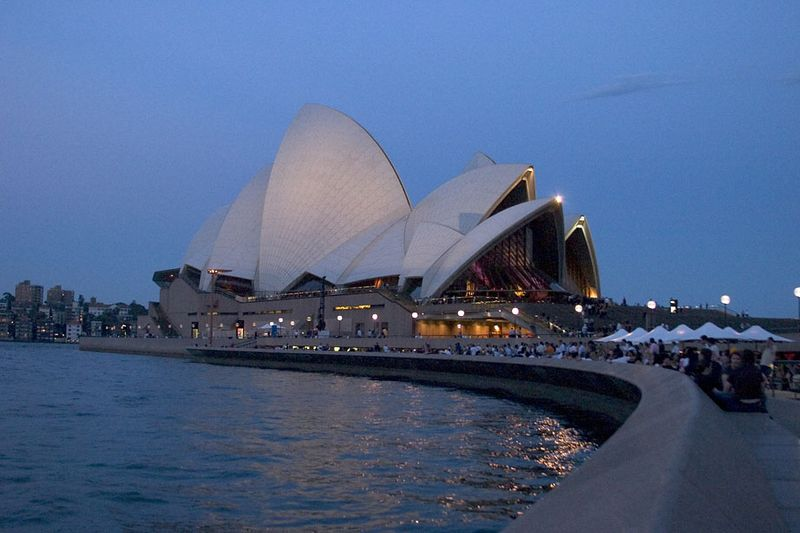 Sydney Opera House lights up the night at Circular Quay, Sydney, New South Wales, Australia