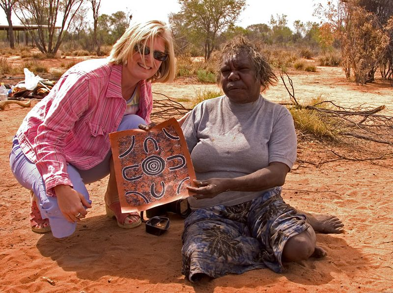 Collette vacationer purchases art from an Aboriginal artist, Rod Steinert's Dreamtime Cultural Tour, Alice Springs, Nothern Territory, Australia