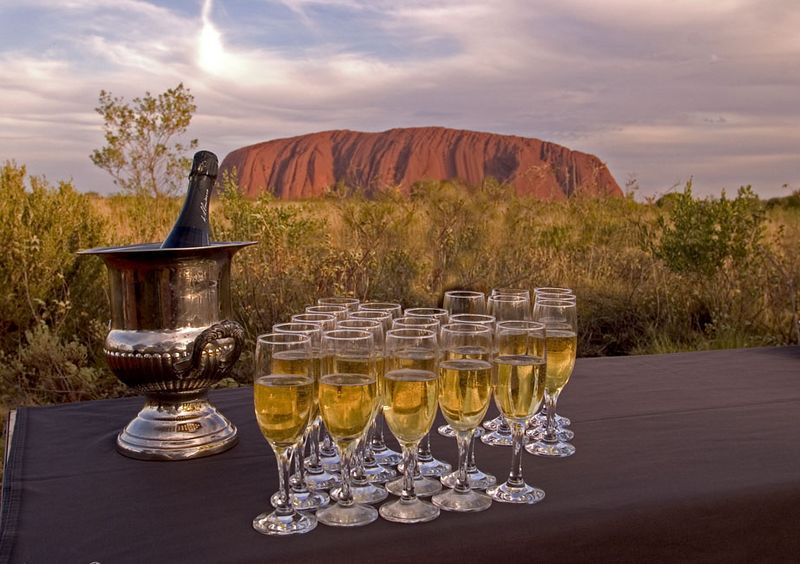 Champagne at sunset, an evening tradition, Uluru National Park, Australia