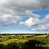 A scenic view of emerald green farms, blue sky and clouds at Hawkridge, Exmoor National Park, North Devon, England, U.K.