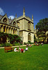 students enjoy a sunny day relaxing on the quad lawn of Fellows College, Oxford, England