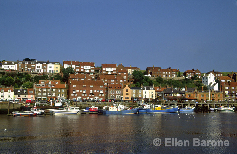 The picturesque quayside of Whitby's harbour and the River Esk, Whitby, Yorkshire, England.