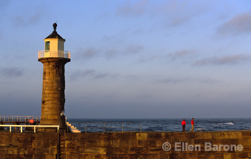 An evening stroll, Whitby Lighthouse and Pier, Whitby, Yorkshire, England