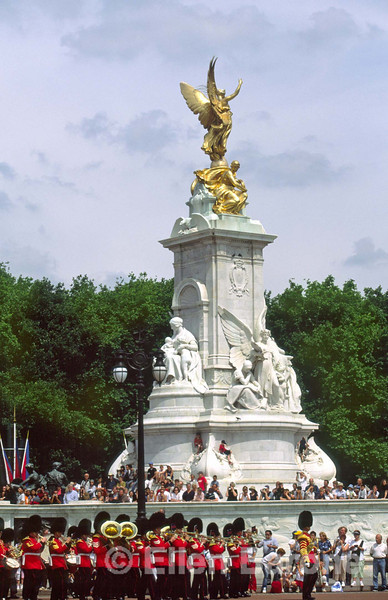 The Victoria Memorial, a statue of Queen Victoria, and the Changing of the Guard ceremonial parade, Buckingham Palace, London, England.