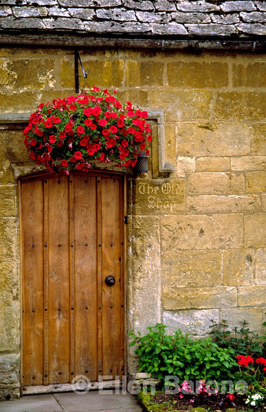 doorway, traditional Cotswold stone cottage,'the old shop', Snowshill, the Cotswolds, England