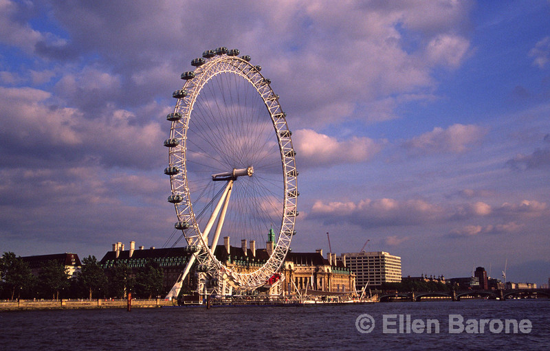 Spectacular evening light and stormy sky form a dramatic backdrop to British Airways' London Eye, the tallest observation wheel in the world, South Bank of the Thames, London, England.