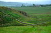 A lovely stretch of Hadrian's Wall (AD 120), a 73 mile (117 km) wall erected across northern England to defend the northern limits of the Roman Empire, can be viewed from the Steel Rigg Viewpoint, Northumberland, England.