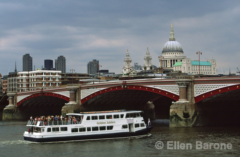 One of the most enjoyable ways to see the city is by boat, Blackfriars Bridge with St. Paul's Cathedral in the distance, the Thames,  London, England.