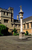 Corpus Christi College, founded 1517, the quad's sundial topped by the pelican, the college symbol, bears an early 17th century calendar, Oxford, England