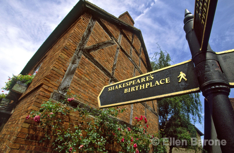 Directional signpost at Shakespeare's Birthplace, a museum and top tourist attraction,  Stratford-Upon-Avon, England