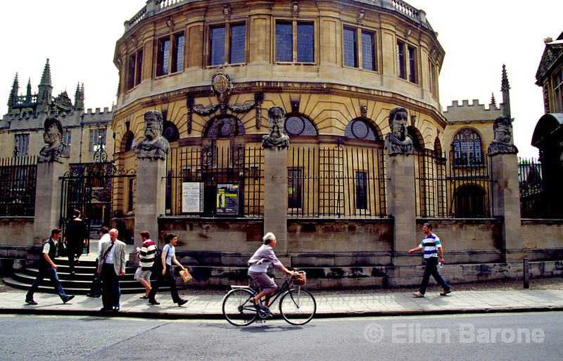 Life strolls by Sheldonian Theater, the first building designed by Sir Christopher Wren, is now used for University graduation ceremonies,  Oxford, England