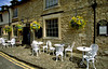 Sidewalk cafe, The Castle Inn, Castle Combe, the Cotswolds, near Bath, England.