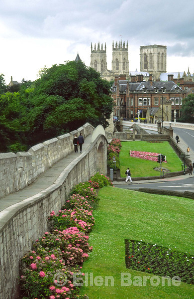 York's first walls were Roman, substantial fragmants of these still remain but it is the restored medieval walls which now encircle the old city that offer visitors a delightful elevated view of the city. York, Yorkshire, England.