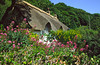 A lovely thatched roof cottage and thriving garden, Lulworth Cove, Isle of Purbeck, Dorset Coast, England.