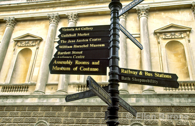 Directional signs point to all the top visitor attractions, Bath, England.