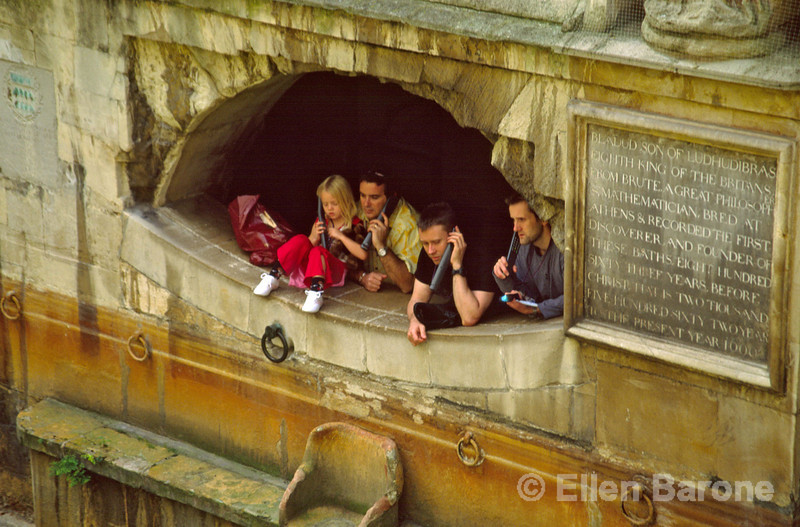 Using prerecorded listening devices, a self guided tour of the Roman Baths offers visitors of all ages the ability to tour at their own pace, Bath, England.