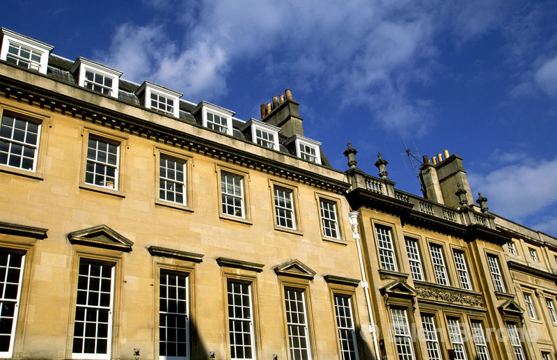The lovely honey-colored Georgian buildings, so characteristic of the city, form a elegant backdrop to city life, Bath, England.