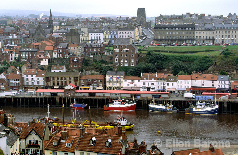 The historic maritime town of Whitby tumbles down the hillside banks of the River Esk. Whitby, Yorkshire, England.
