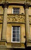 Architectural detail, exterior facade, the Roman Baths, Bath, England.