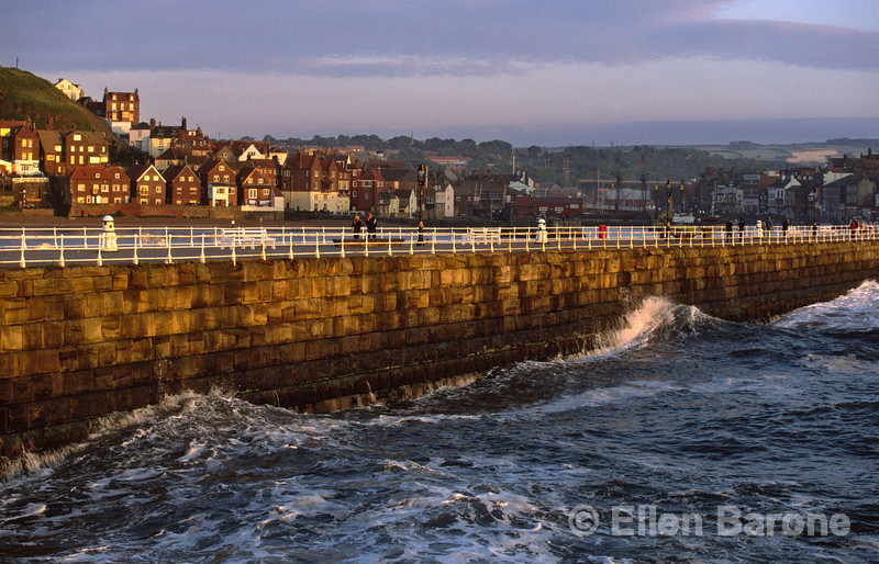 The quayside of Whitby's historic harbour is most beguiling in the warm glow of evening light, Whitby, Yorkshire, England.