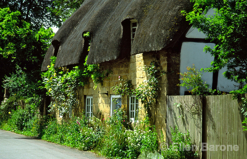 A blend of architectureal styles, tradtional thatched roof, Cotswold stone and half-timbered Tudor style, cottage, Broadway, the Cotswolds, England.