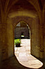 An arched entrance in golden sandstone, Merton College, on of Oxford's oldest, Oxford, England