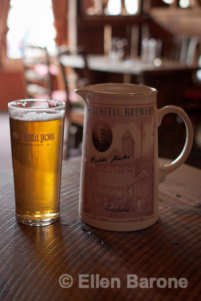 A pint of Proper Job, an authentic IPA brewed with Cornish spring water and a blend of malts by St Austell Brewery, The Royal Oak, Winsford, Exmoor, England, U.K.